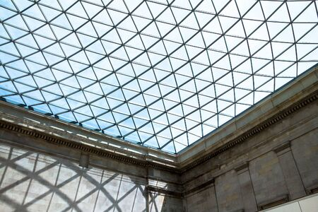 glass ceiling: LONDON, UK - JUNE 4, 2015:  The British Museum glass ceiling. Museum was established in 1753, largely based on the collections of the physician and scientist Sir Hans Sloane. Editorial