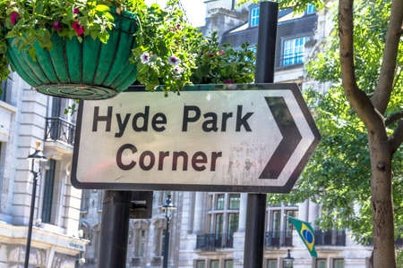 indicates: Pedestrian signpost with indicates direction of movement in  Hyde park. London. UK