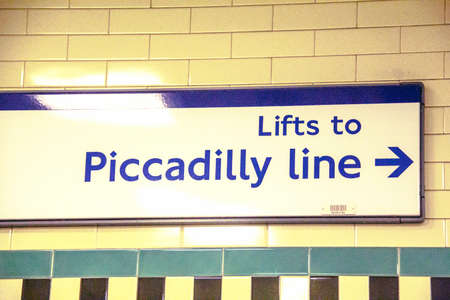 piccadilly: Sign indicates direction of movement to Piccadilly line at Russell Square underground station. London, UK Editorial