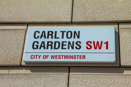 westminster city: Street sign of  Carlton Gardens  in City of Westminster on white plate at Central London