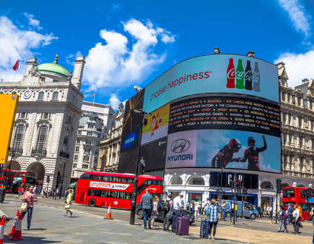 eros: View of Piccadilly Circus with unidentified tourists and locals in London. Billboards famous brands have been here for at least 20 years and are considered symbols of famous square. London,UK Editorial