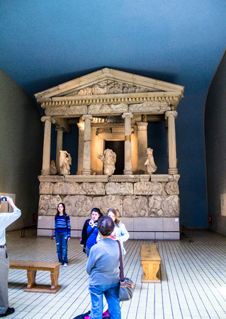 lon: Unidentified visitirs in the hall with Nereid Monument, finest of the Lykian tombs found at Xanthos, in what is now SW Turkey. Dated to about 390-380 BC, it is named for the statues of the Nereids, daughters of the sea god Nereus, between its columns. Lon