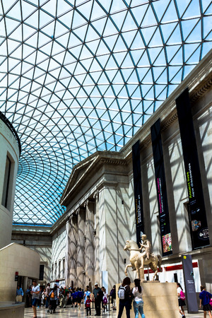 glass ceiling: Unidentified visitirs inside  interior of old British museum with modern glass ceiling. London,UK Editorial
