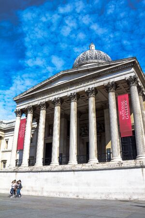 western european: Unidentified  tourists near  National Gallery in Trafalgar Square. The gallery houses a collection of Western European painting from the 13th to the 19th centuries. London, UK.