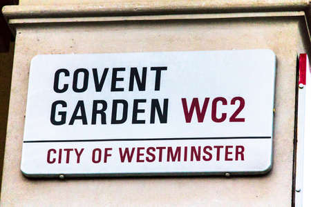 covert: Covert Garden Street sign  in City of Westminster  on white at Central part of city. London, UK.