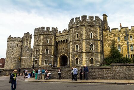 prince charles of england: Unidentified visitors near the exit from Medieval Windsor Castle. Windsor Castle is a royal residence at Windsor in the English county of Berkshire. UK