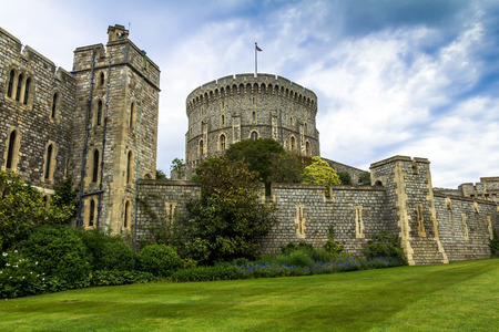 donjon: Donjon - the great tower or innermost keep of a Medieval Windsor Castle. Windsor Castle is a royal residence at Windsor in the English county of Berkshire. It was built in 1066 by William the Conqueror and it is the longest-occupied palace in Europe.  Win Editorial