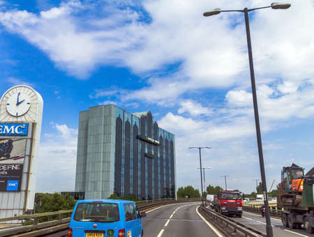 rd: Vantage West Credit Union  and  building on cloudy sky background. M4. Great West Rd, Brentford, Greater London. UK