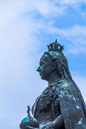 plinth: Statue of Queen Victoria on a plinth in the road near Medieval Windsor Castle in the  County of Berkshire. UK