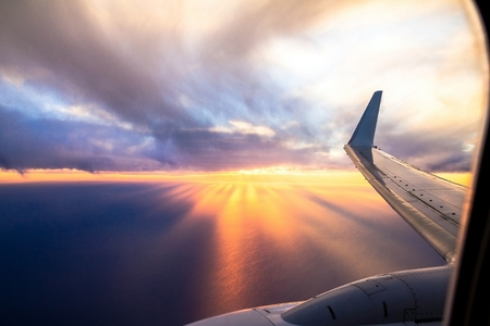 Wing aircraft at sunset. Looking Out Through Airplane Window Reklamní fotografie - 52134374