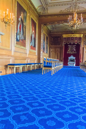 the royal county: Interior of royal palace in medieval Windsor Castle. Windsor Castle is a royal residence at Windsor in the English county of Berkshire. It was built in 1066 by William the Conqueror and it is the longest-occupied palace in Europe.London, UK Editorial