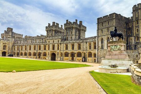 Exterior stone medieval residential complex with courtyard inside Windsor Castle. Windsor Castle is a royal residence at Windsor in the English county of Berkshire.It was built in 1066 by William the Conqueror and it is the longest-occupied palace in Euro Editorial