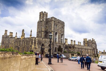 the royal county: Unidentified visitors inside medieval Windsor Castle. Windsor Castle is a royal residence at Windsor in the English county of Berkshire. It was built in 1066 by William the Conqueror and it is the longest-occupied palace in Europe. UK