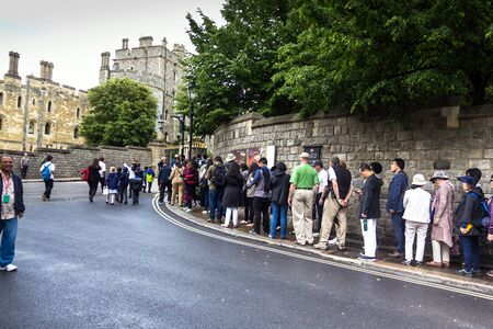 the royal county: Unidentified visitors queuing in front of the  medieval Windsor Castle. Windsor Castle is a royal residence at Windsor in the English county of Berkshire. UK