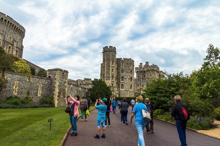 the royal county: Unidentified visitors near medieval buildings inside Windsor Castle. Windsor Castle is a royal residence at Windsor in the English county of Berkshire. UK