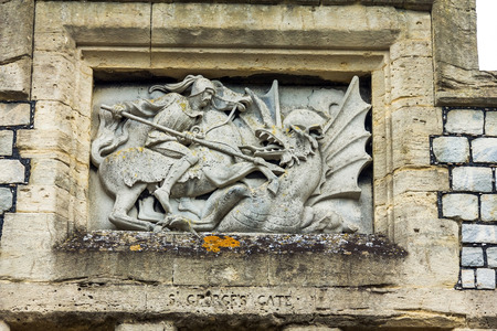 berkshire: Medieval bas-relief above the gate of St. George in the interior of Windsor Castle. Windsor Castle is a royal residence at Windsor in the English county of Berkshire. UK Editorial