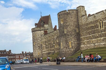 curfew: Unidentified tourists near Curfew Tower, part of the Lower Ward in medieval Windsor Castle. Windsor Castle is a royal residence at Windsor in the English county of Berkshire. UK