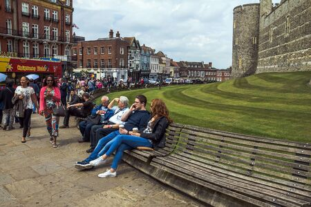 the royal county: Unidentified tourists near  Lower Ward in medieval Windsor Castle. Windsor Castle is a royal residence at Windsor in the English county of Berkshire. UK