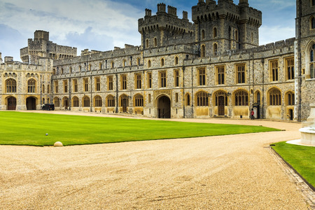 the royal county: Exterior stone medieval residential complex with courtyard inside Windsor Castle. Windsor Castle is a royal residence at Windsor in the English county of Berkshire.It was built in 1066 by William the Conqueror and it is the longest-occupied palace in Euro Editorial
