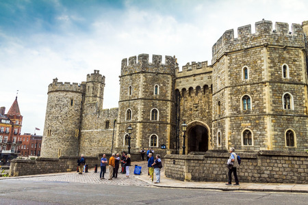Unidentified visitors near the exit from Medieval Windsor Castle. Windsor Castle is a royal residence at Windsor in the English county of Berkshire. UK Stock Photo - 52114842