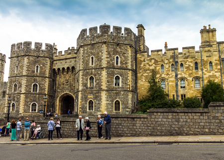 the royal county: Unidentified visitors near the exit from Medieval Windsor Castle. Windsor Castle is a royal residence at Windsor in the English county of Berkshire. UK