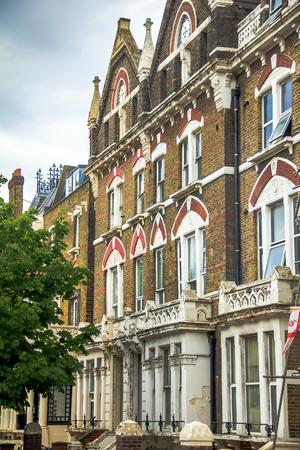 kensington: Old apartment red brick houses in Kensington Olympia, London, England, United Kingdom Editorial