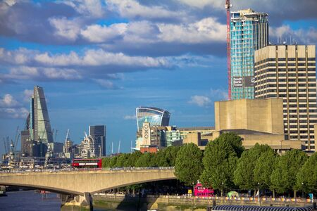 lloyds london: Cityscape of London in late afternoon light from Hungerford Bridge. London. UK