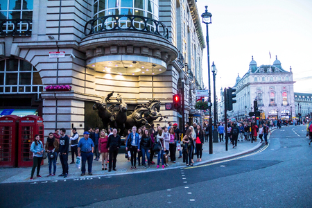 rudy: Tourists visit famous Piccadilly Circus   that has become one of major attraction of London with The Horses of Helios, also known as The Four Bronze Horses of Helios fountain. London. UK