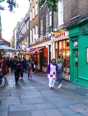 british ethnicity: People walk along a busy shopping street in Londons Chinatown. Over 120,000 people of Chinese ethnicity live in the British capital, 33 of the UKs Chinese population. London, Editorial