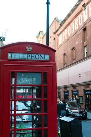 hippodrome: Unidentified people near red telephone booth in central London near  Hippodrome Casino. London. UK