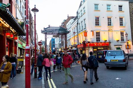 british ethnicity: People walk along a busy shopping street in Londons Chinatown. Over 120,000 people of Chinese ethnicity live in the British capital, 33 of the UKs Chinese population. London. UK