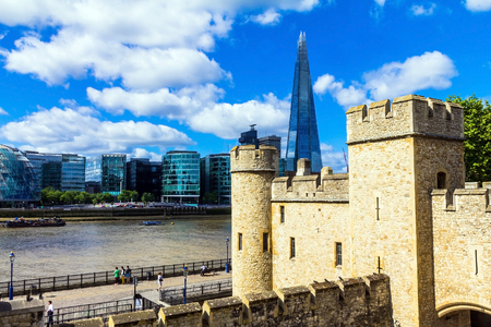 tallest bridge: The Shard towering over London on blue sky background,  tallest building in Europe at over 1,000 feet 310 metres. View from Tower of  London