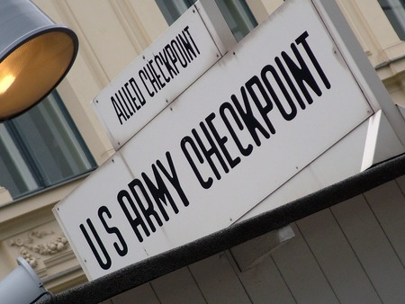 cold war: Checkpoint Charlie sign. Checkpoint Charlie was between east and west sectors during the Cold War. Berlin