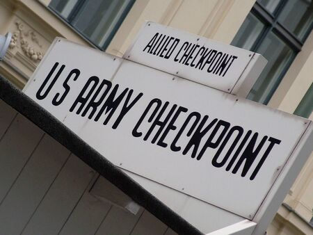 sectors: Checkpoint Charlie sign. Checkpoint Charlie was between east and west sectors during the Cold War. Berlin