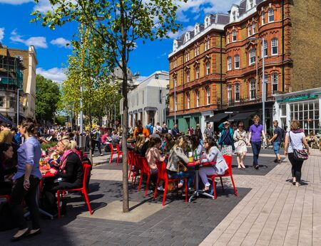 unidentified: Unidentified tourists and locals at South Kensington area at summer day near  Casa Brindisa restaurant. London