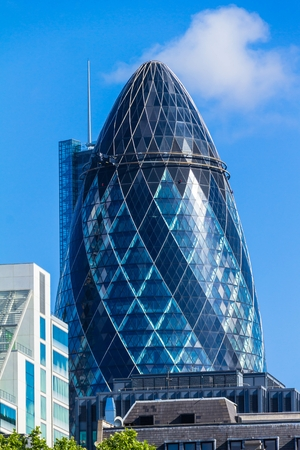 30 st mary axe: View of Gherkin building (30 St Mary Axe) on blue sky background. London