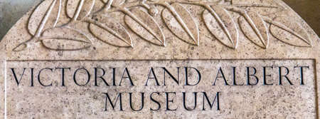 albert: Victoria and Albert Museum stone sign in the lobby. London Editorial