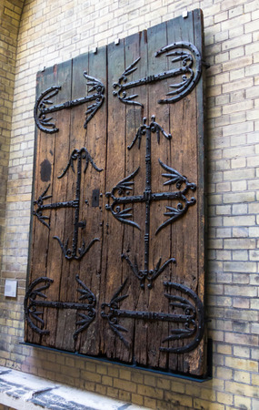 ironwork: Pair of doors with ironwork,  from Gannat in France, Oak with wrought iron, 1200-1300. Victoria and Albert museum Editorial