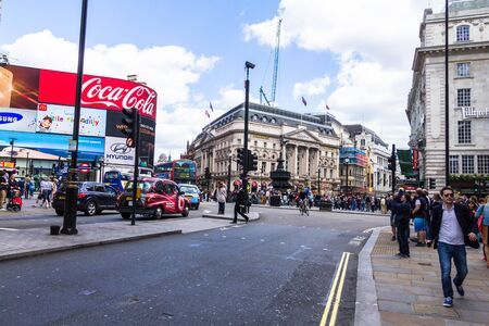 west end: People and traffic in Picadilly Circus. London. A famous public space in Londons West End Editorial
