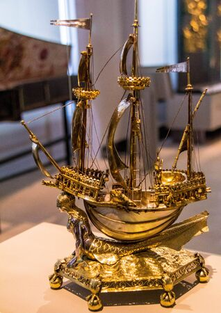 chased: Salt cellar (The burghley Nef). 1527- 1528. Made in Paris, France. Nautilus shell with parcel-gilt silver mounts, raised, chased, engraved and cast, and pearls.  Victoria and Albert museum. London