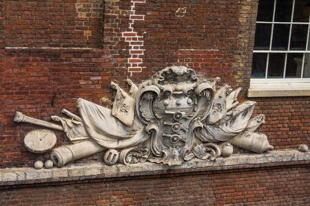 house coat: Coat of arms on a facade of an old house at Tower of London Stock Photo