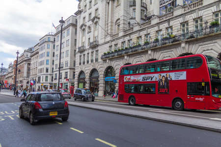 strret: Unidentified people and traffic in Piccadilly street . The city is visited by more than 30 million people every year. London,UK