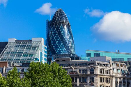 30 st mary axe: Clouds floating over the City of London with a Gherkin building (30 St Mary Axe) Editorial