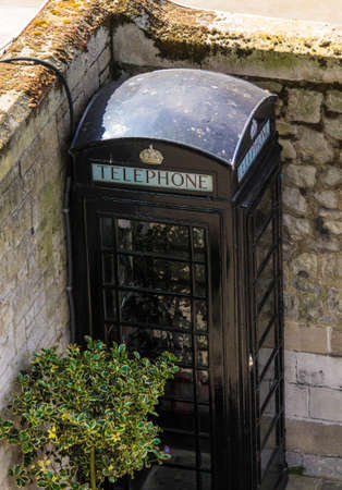 telephone booth: Black telephone booth in Tower of London, UK