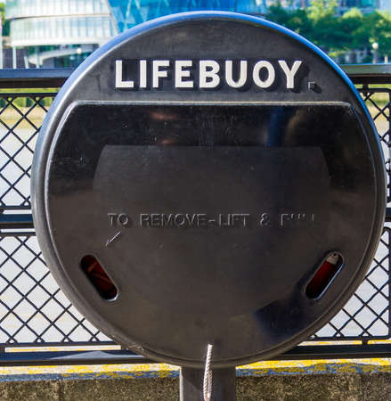 lifebuoy: Lifebuoy on the bank of Thames at the Tower of London. London. UK