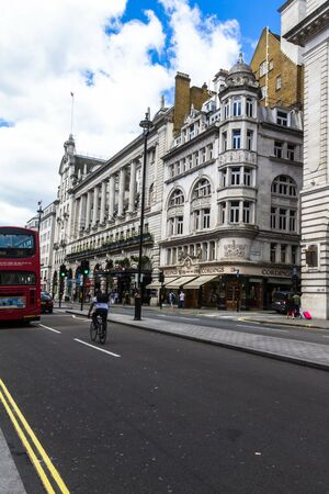 strret: Unidentified people and traffic in Piccadilly street . The city is visited by more than 30 million people every year. London