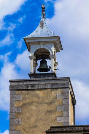 watchdog: LONDON, UK - JUNE 6, 2015: Watchdog bell on top of the Watchtower of the Tower of London castle on blue sky background. London,UK