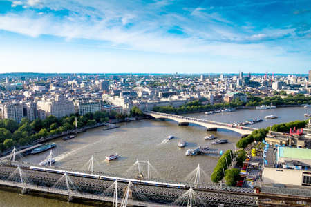 millennium wheel: LONDON, UK - JUNE 6, 2015: Cityscape from London Eye  cabin.  London Eye is a giant Ferris wheel situated on the banks of the River Thames