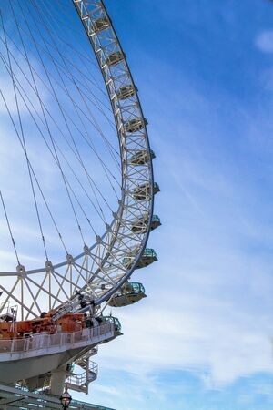 incidental people: LONDON, UK - JUNE 6, 2015: London Eye . London Eye is a giant Ferris wheel situated on the banks of the River Thames