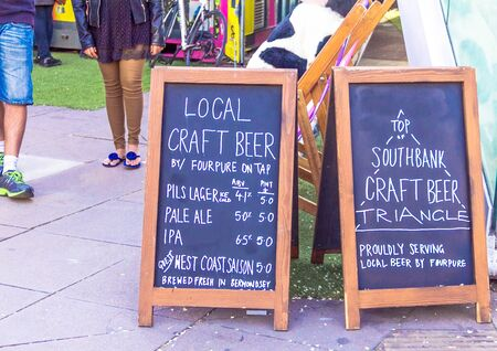 near beer: LONDON, UK - JUNE 6, 2015: Advertising  of draft craft beer  sale near  pub on the south bank of the River Thames